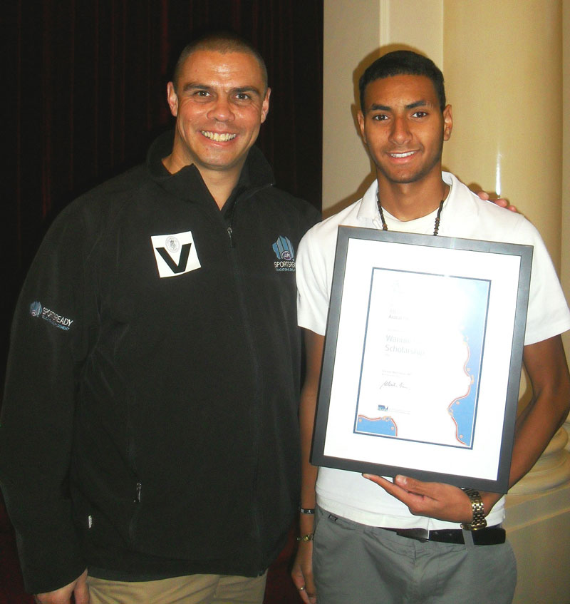 Kyle Vander Kuyp (left) presents Michael Naawi (right) with the Wannik Education Scholarship.
